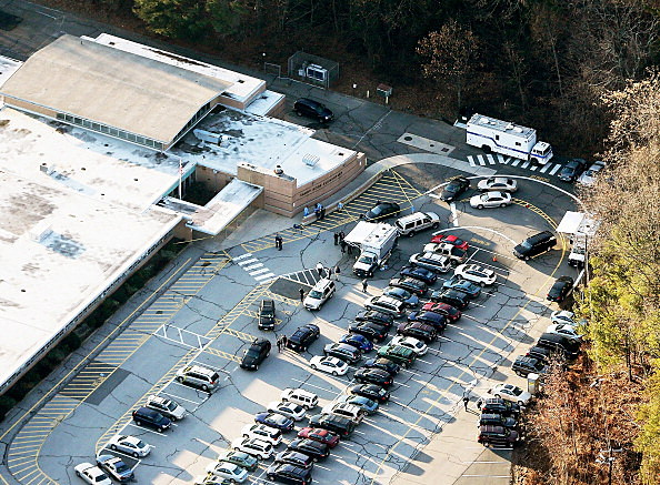 Responders gather at the scene of a mass school shooting at Sandy Hook Elementary School