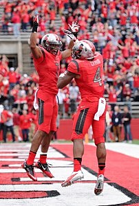 Quron Pratt #7 of the Rutgers Scarlet Knights celebrates with Leonte Carroo #4 after Carroo scored the game winning touchdown against the Temple Owls at High Point Solutions Stadium