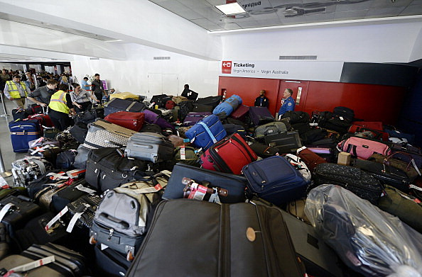 Luggage waits to get screened for departure in Terminal 3 a day after a shooting at Los Angeles International Airport