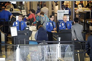 ravelers are screened byTransportation Security Administration agents after Terminal 3 was re-opened a day after a shooting at Los Angeles International Airport