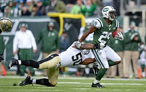 Running back Bilal Powell #29 of the New York Jets is tackled by middle linebacker Curtis Lofton #50 of the New Orleans Saints