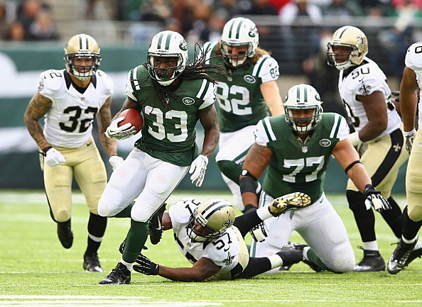 Chris Ivory #33 of the New York Jets eludes the tackle of David Hawthorne #57 of the New Orleans Saints