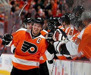 Claude Giroux #28 of the Philadelphia Flyers is congratulated by teammates on the bench after he scored in the third period against the Edmonton Oilers