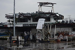 Rescuers inspect the heavily damaged airport in the aftermath of typhoon Haiyan  in Tacloban City, Leyte, Philippines