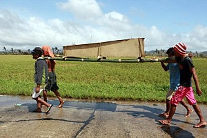 Residents carry a coffin in Santa Fe, Leyte, Philippines.
