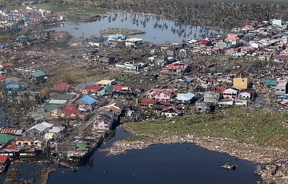 an aerial view of buildings destroyed in the aftermath of Typhoon Haiyan on November 10, 2013 over the Leyte province, Philippines