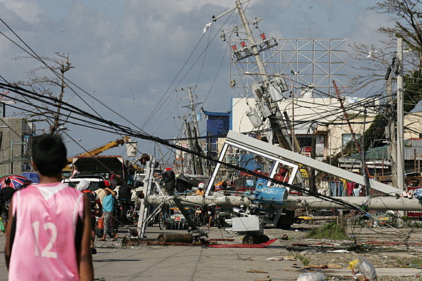Downed power lines and debris block the road in the aftermath of Typhoon Haiyan in Tacloban, Leyte, Philippines.
