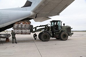 Palletized equipment is loaded onto a KC-130J Hercules aircraft at Marine Corps Air Station Futenma during preparation for a humanitarian assistance and disaster relief mission to the Philippines