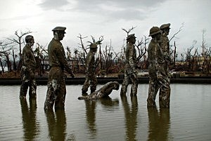 Statues of soldiers at the General Douglas Mcathur Leyte Landing Memorial were not spared by raging winds in an area devastated by Typhoon Haiyan in Leyte, Philippines