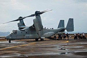 Stranded American missionaries are evacuated by US troops on a V22 Osprey on in Leyte, Philippines