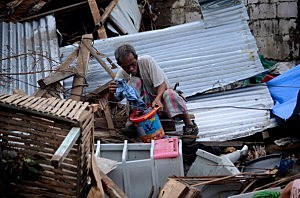 A man salvages materials in an area devastated by Typhoon Haiyan in Leyte, Philippines.