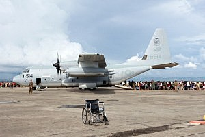 Residents departing for Manila board a US Marines C-130 plane in the aftermath of Typhoon Haiyan