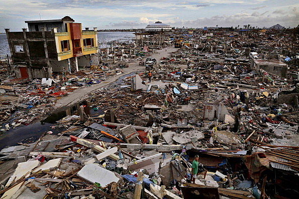 Residents search through rubble amid scenes of devastation in the aftermath of Typhoon Haiyan in Tacloban, Leyte, Philippines