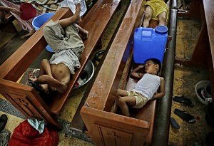 Residents take shelter in a church in the aftermath of Typhoon Haiyan