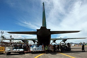 A relief plane is unloaded in the aftermath of Typhoon Haiyan in Tacloban, Leyte, Philippines