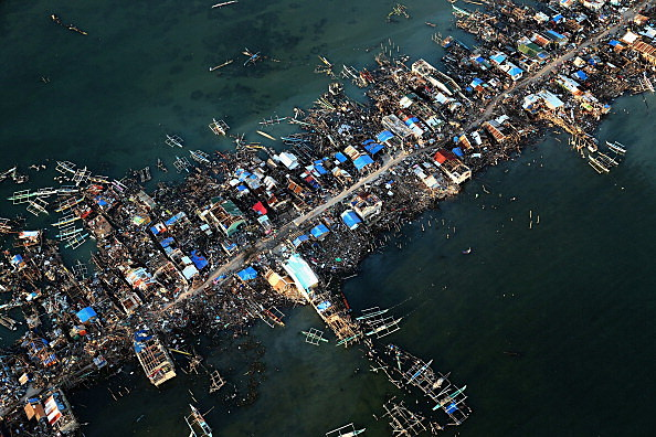 An aerial view of a demolished coastal town on Eastern Samar Island  in Leyte, Philippines.