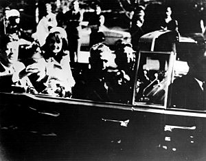 President John F. Kennedy (1917 - 1963) and his wife Jacqueline Kennedy ride with secret agents in an open car motorcade shortly before the president was assassinated in Dallas, Texas, November 22, 1963. (Photo by Keystone/Getty Images)