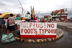 Residents appeal for help in the aftermath of the recent super typhoon in Tanauan, Leyte, Philippines