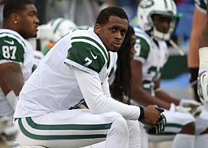 Geno Smith #7 of the New York Jets looks on from the bench after throwing an interception