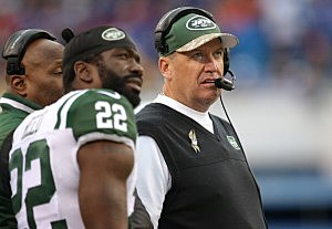 Rex Ryan of the New York Jets and Ed Reed #22 look on from the sideline