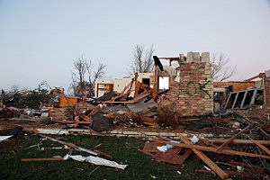 A home sits in ruin along Elgin Avenue after a tornado struck in Washington, Illinois.