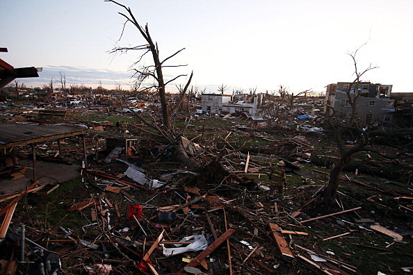 Debris covers the area after a tornado struck  in Washington, Illinois
