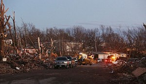 The damage is surveyed along Elgin Avenue after a tornado struck in Washington, Illinois