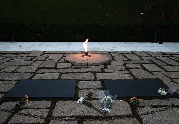 The eternal flame burns at the gravesite of the 35th President of the United States John F. Kennedy, at Arlington National Cemetery