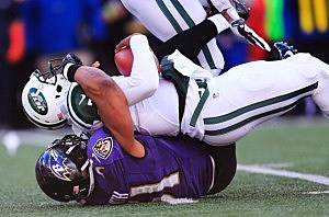 Inside linebacker Daryl Smith #51 of the Baltimore Ravens sacks Jets quarterback Geno Smith