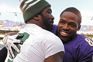 Wide receiver Torrey Smith #82 of the Baltimore Ravens hugs Ed Reed #22 of the New York Jets