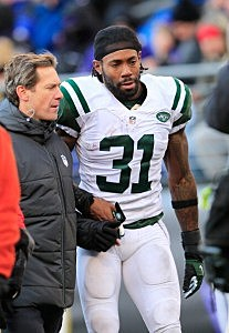 Cornerback Antonio Cromartie is led off the field