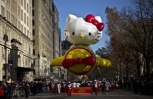 The Hello Kitty balloon floats above the street during the Macy's Thanksgiving Day Parade