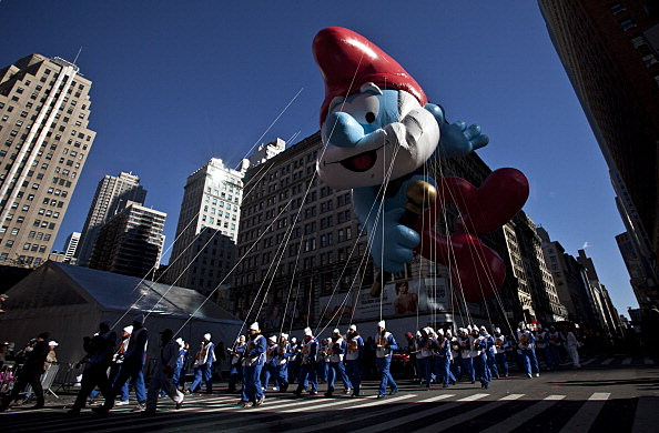 The Papa Smurf balloon floats above the street during the Macy's Thanksgiving Day Parade