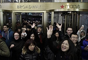 People enter Macy's Herald Square as the store opens its doors at 8 pm Thanksgiving day