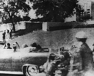 President John F. Kennedy (1917 - 1963) is struck by an assassin's bullet as he travels through Dallas in a motorcade, 22nd November 1963