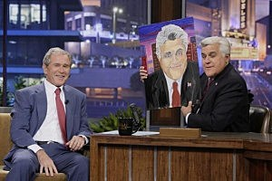 Forme President George W. Bush presents a painting he made of Jay Leno to the Tonight Show host