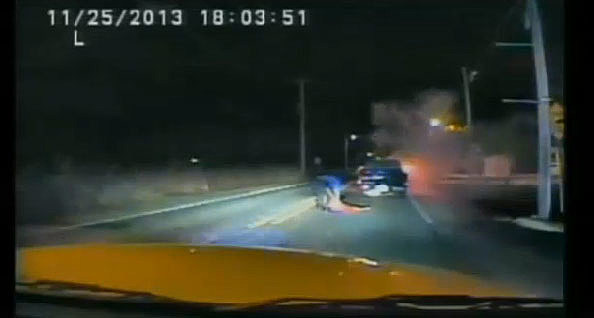 Cape May police officer Scott Krissinger pulls a man from a burning vehicle