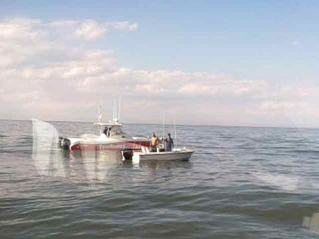 A boat crew from Coast Guard Station Cape May responds to a boater in distress off South Jersey.