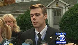 Kevin Shoop talks to reporters about his brother outside the family home in Teaneck