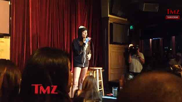 Patricia Krentcil on stage doing stand-up comedy