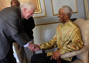 Nelson Mandela is reunited with Jimmy Carter as other members of the Edlers watch on May 29, 2010 in Johannesburg, South Africa.