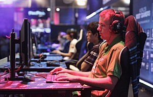 Gaming enthusiasts play World of Warcraft at the Gamescom 2012 gaming trade fair