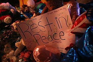 A sign adorns a memorial for shooting victims in Newtown, Connecticut.