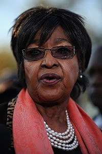Former wife of Nelson Mandela Winnie Madikizela-Mandela speaks to the press outside Nelson Mandela House in Soweto on June 28, 2013 in Johannesberg, South Africa.