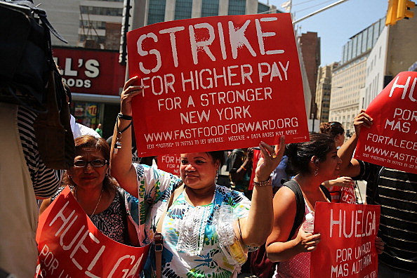 Employees and supporters demonstrate to demand higher pay and the right to form a union in New York during a strike in July
