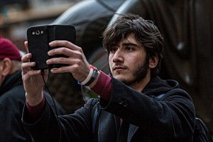 "A man takes a ""selfie"" outside Rockefeller Center"