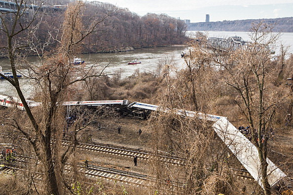 Emergency crews respond after Metro-North train derailed near the Spuyten Duyvil station