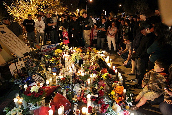 A general view of atmosphere as fans pay tribute to actor Paul Walker at crash site
