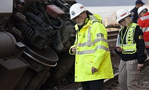 NTSB Investigator In Charge Michael Flanigon inspects the track after a Metro North train derailment