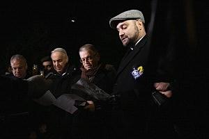 Religious leaders take part in a vigil and memorial service for train derailment victims